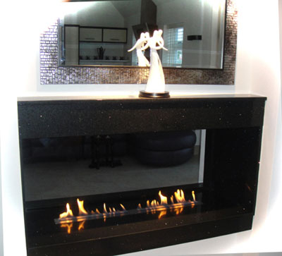 Two Bio Containers in a granite, see-through fireplace. Picture: courtesy of a customer David Hildred